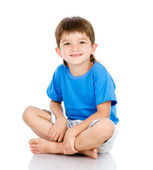 Portrait of young boy sitting — Foto Stock