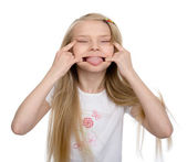 Funny little girl makes a silly face — Stock Photo