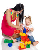 Happy Mother with Daughter playing with blocks — Stock Photo