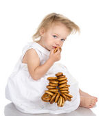 Baby girl eating bread. — Stock Photo