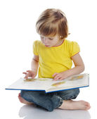 Little girl reading a book — Foto de Stock