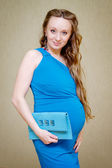 Portrait of pregnant woman holding her belly. — Stock Photo