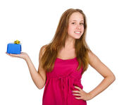 Young girl giving a present. isolated over white background — Stock Photo