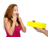 Surprised girl accepting gift box. isolated on white background — Stock Photo