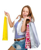 Joven adolescente holding bolsas. aislado sobre fondo blanco — Foto de Stock