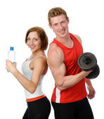 Athletic woman and man with a dumbells. isolated on white background — Stock Photo