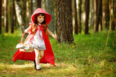 The girl runs on the wood. — Stock Photo
