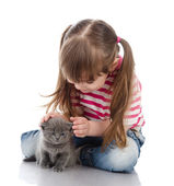 Little cute girl affectionately hugging kitten. isolated on white background — Stock Photo