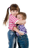 Lovely little sister embracing her baby brother. isolated on white background — Stock Photo