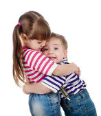Lovely little sister embracing her baby brother. isolated on white background — Foto de Stock