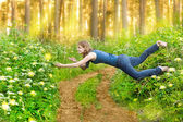 Young woman levitating in the wood — Stock Photo