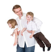 The father has fun with the son and the daughter. isolated on white background — Stock Photo