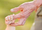 Hands family grandson and old grandfather — Stock Photo