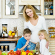Stock Photo: Mother and her kids in kitchen