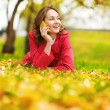 Young woman talking on cell phone in the autumn park — Stock Photo #18034205