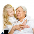 The girl embraces the old woman - Stock Photo