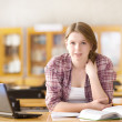 Female student with laptop working in library — Stock Photo #18034497