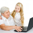 Young girl and old woman look in the monitor — Stock Photo