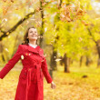 Beautiful young woman in autumn park - Stock Photo