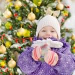 Happy girl near the decorated christmas tree — Stock Photo #18034689