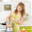 Pregnant womusing juicer — Stock Photo #18034721