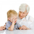 Grandmother talks to grandson — Stock Photo #18034799