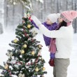 Mother and the daughter decorate a Christmas tree — Stock Photo