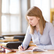 Stock Photo: Student with touchpad in library