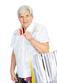 Old woman with shopping bags and credit card — Foto Stock