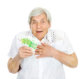 Happy old woman holding money — Stock Photo