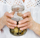 Senior woman hands holding jar with coins closeup — Stock Photo