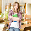 Female student in library — Stock Photo #19220225