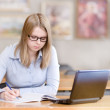 Female student with laptop working in library — Stock Photo #19220239