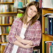 Happy girl at the library. looking at camera — Stock Photo #19220349