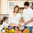Happy family in kitchen - Stock Photo