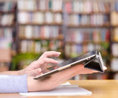 Hands typing on tablet in college class — Stock Photo