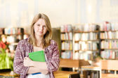 Female student in library — Foto Stock
