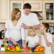 Happy family in kitchen — Stock Photo