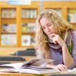 Royalty-Free Stock Photo: Female student in library.