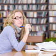 Female student in library. — Stock Photo #20256957