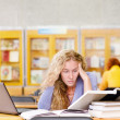 Female student in library. — Stock Photo #20257039