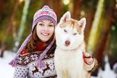 Happy woman playing with husky outdoors — Stok fotoğraf