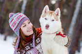 Closeup teen girl embracing cute dog in winter park — Zdjęcie stockowe
