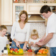 The happy family makes a dinner in kitchen — Stock Photo