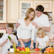 The happy family makes a dinner in kitchen — Stock Photo #21882283