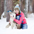 Portrait of a pretty young woman with her pet dog — Stock Photo