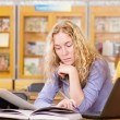 Royalty-Free Stock Photo: Female student with laptop working in library