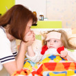 Sick child and mother — Stock Photo