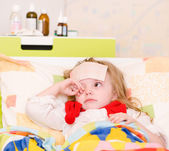 Sick and sad child preschool age in bed — Stock Photo