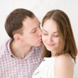 Royalty-Free Stock Photo: Careful man kissing his smiling girlfriend